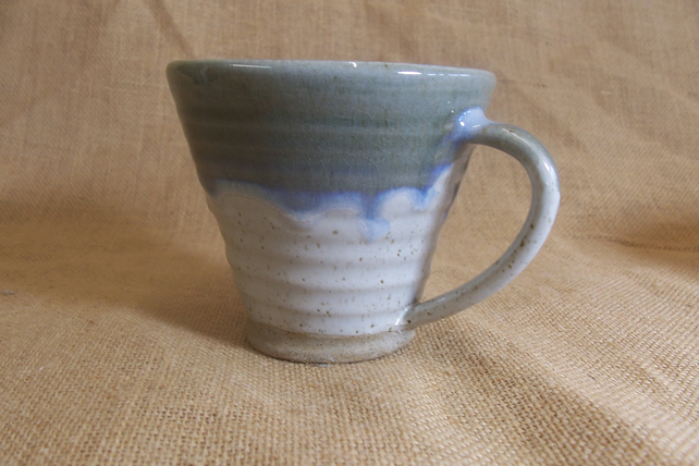Stoneware coffee mug, tea cup. With speckled white and blue beige glaze.