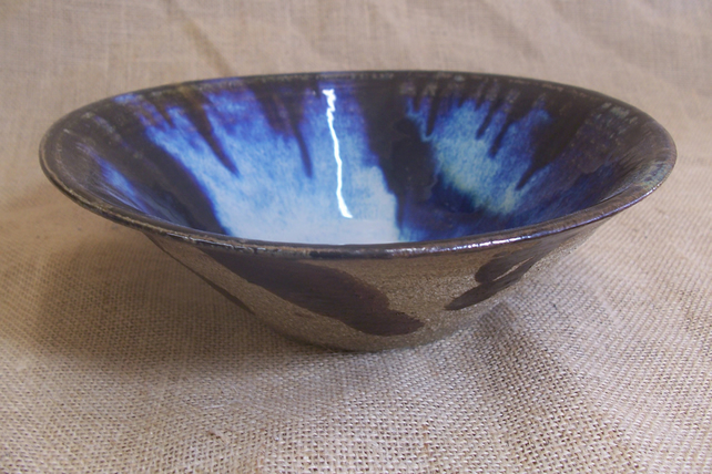 Thrown and altered bowl. Glazed in multiple glazes.