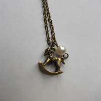 Cute Bronze Rocking Horse and Pearl Necklace