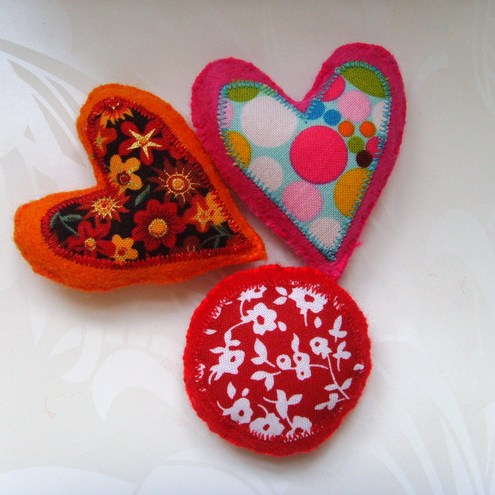 red, pink and orange patterned magnets
