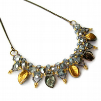 Sapphira - Blue and Gold Beaded Leaf Necklace