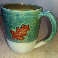 Generous oak leaf decorated mugs