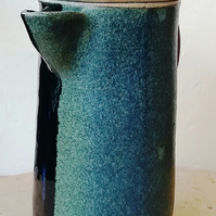 Multi-coloured coffee or juice jug