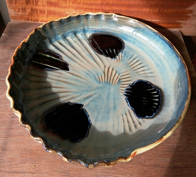 Scalloped edged ceramic dishes