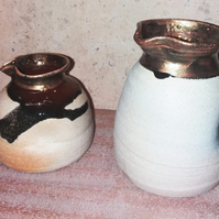 Little and larger organic pinched pouring jugs