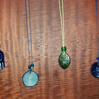 Mixed bead and ceramic pendants on adjustable chord