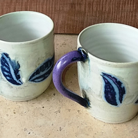 Leaf wax resist decorated mugs