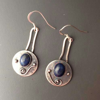 Silver and blue dangle shield earrings