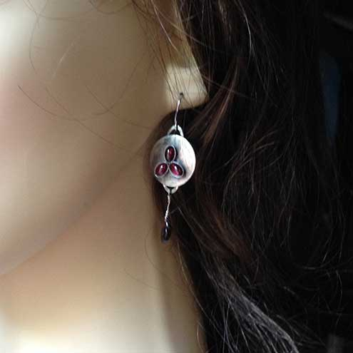 Silver and red dangle shield earrings