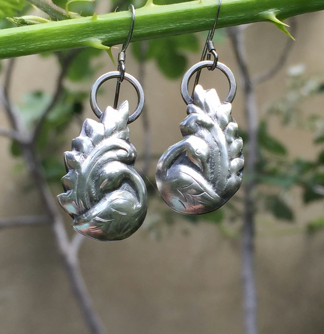 Silver preening bird earrings
