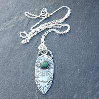 Stamped silver and turquoise pendant