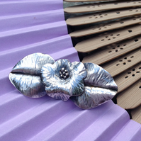 Silver flower and leaves brooch