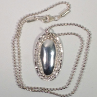 Silver oval domed pendant