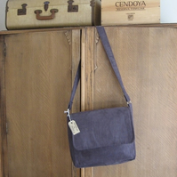 Purple faux suede messenger bag