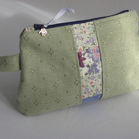 Green linen and purple floral print cosmetic bag