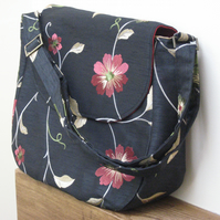 Black, red & gold messenger bag with floral embroidery
