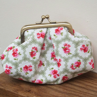 Green, pink and cream puffy metal frame purse