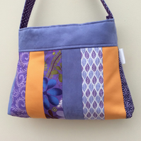 Lilac and tangerine patchwork handbag with Kate Spain print fabric