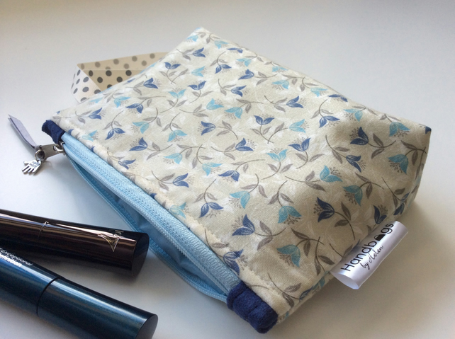 Pale blue and grey floral print cosmetic bag