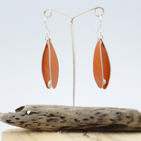 Anodised aluminium orange seed pod dangly earrings with pearl