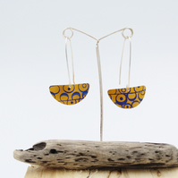 Orange long drop semi circle seed head earrings