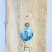 Teal anodised aluminium cow parsley circle pendant  with freshwater pearl