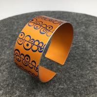 Orange and blue anodised aluminium seed head cuff