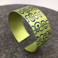 Lime green and blue anodised aluminium seed head cuff