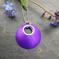 Circular, purple, anodised aluminium, leaf textured pendant with silver ring.