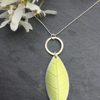 lime green anodised aluminium distressed leaf pendant with silver ring