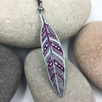 Long length hand printed anodised aluminium feather in purple.