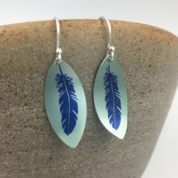 Anodised aluminium blue and teal hand printed feather earrings