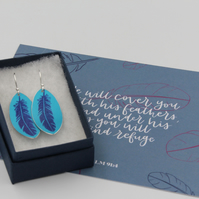 Anodised aluminium pink oval feather earrings and postcard set.