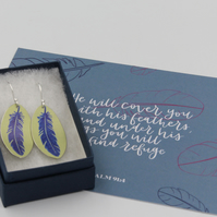 Lime green anodised aluminium oval feather earrings and postcard set.