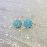Small anodised aluminium ocean wave studs in turquoise