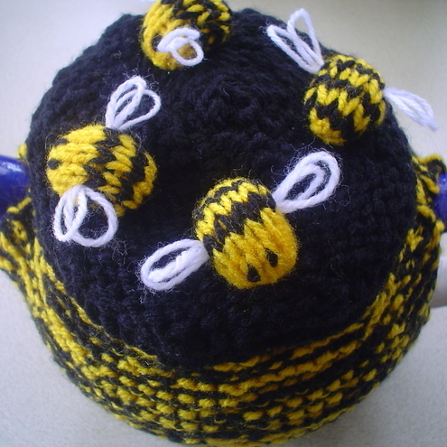 HAND KNITTED TEA COSY DECORATED WITH BEES......reduced price