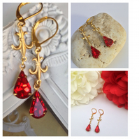 Ruby red vintage glass statement earrings set in golden brass