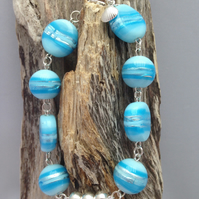 Beach inspired blue glass bead bracelet,sterling silver beads and silver shell