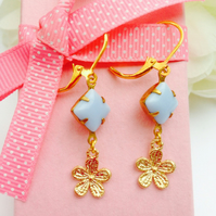 Vintage glass earrings , light opaque lavender  blue with gold flower