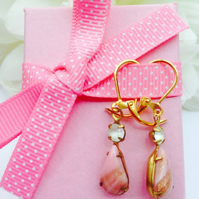 Vintage pink glass earrings with frosted crystal rhinestone.