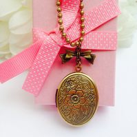 Opening Floral Brass locket necklace with bow