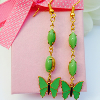 Pretty vintage pea green glass and butterfly earrings. Gift for her.