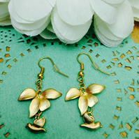 Stunning gold flower and bird earrings