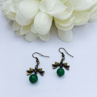 Cute antique gold bow earrings with green vintage glass beads