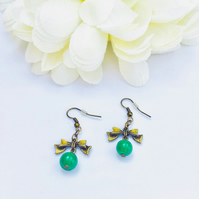 Cute antique gold bow earrings with green vintage glass beads . Valentines.