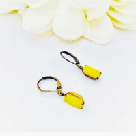Small sunshine yellow vintage glass stone earrings set in brass