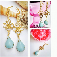 Baby blue glass filgree earrings set in brass with brass earwires
