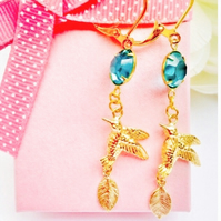 Gold bird, leaf and blue vintage glass earrings.