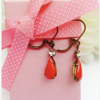 Cherry red vintage glass earrings with rhinestones.
