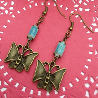 Pretty brass butterfly earrings with blue vintage glass stones